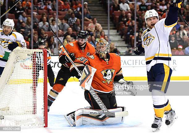 Frederik Andersen of the Anaheim Ducks and Cody Hodgson of the Nashville Predators react to the goal of Calle Jarnkrok during the second period at...
