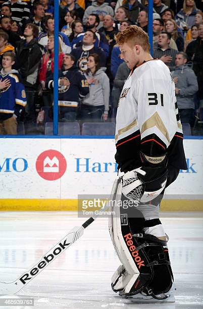 Frederik Andersen of the Anaheim Ducks listens to the national anthem before an NHL game against the St Louis Blues on January 18 2014 at Scottrade...