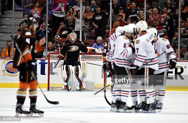 Frederik Andersen of the Anaheim Ducks looks up after allowing a third period goal to Brent Seabrook of the Chicago Blackhawks as he celebrates with...