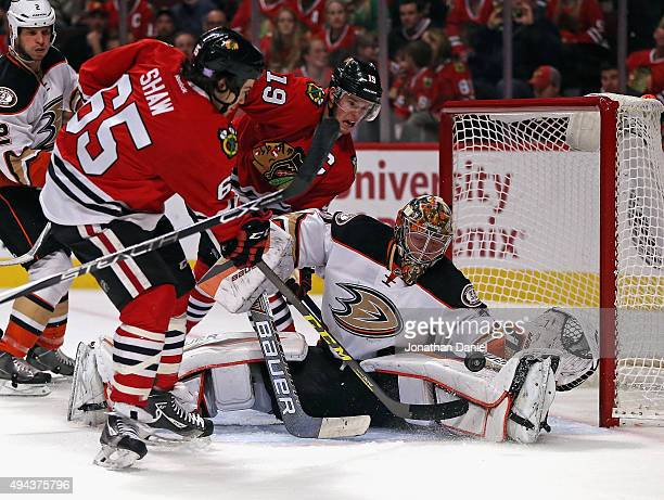 Frederik Andersen of the Anaheim Ducks makes a save on a shot by Andrew Shaw of the Chicago Blackhawks at the United Center on October 26 2015 in...