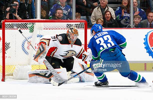 Frederik Andersen of the Anaheim Ducks stops Henrik Sedin of the Vancouver Canucks on a lastsecond breakaway during their NHL game at Rogers Arena...