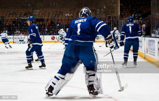 Frederik Andersen of the Toronto Maple Leafs and teammates wear jersey's honouring Leafs legend Johnny Bower during warmup before playing the Tampa...