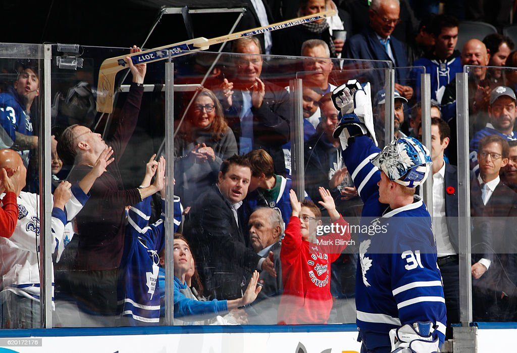TORONTO, ON - NOVEMBER 1 - Frederik Andersen #31 of the Toronto Maple Leafs hands a goalie stick into the crowd after the Leafs defeated the Edmonton Oilers at the Air Canada Centre on November 1, 2016 in Toronto, Ontario, Canada.
