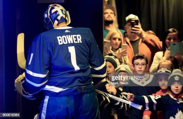Frederik Andersen of the Toronto Maple Leafs heads to the ice for warmup wearing a jersey honouring Leafs legend Johnny Bower b3fore facing the Tampa...