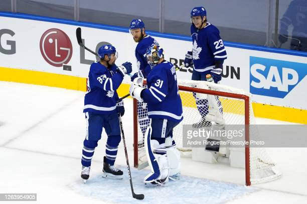 Frederik Andersen of the Toronto Maple Leafs is congratulated by his teammates after their 3-0 win during the third period in Game Two of the Eastern...