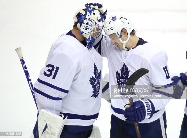 Frederik Andersen of the Toronto Maple Leafs is congratulated by teammate Zach Hyman after the 4-2 win over the Montreal Canadiens during an...