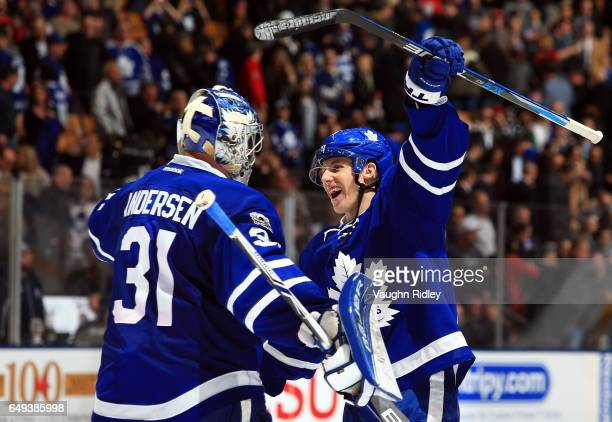 Frederik Andersen of the Toronto Maple Leafs is congratulated by Mitchell Marner following an NHL game against the Detroit Red Wings at Air Canada...