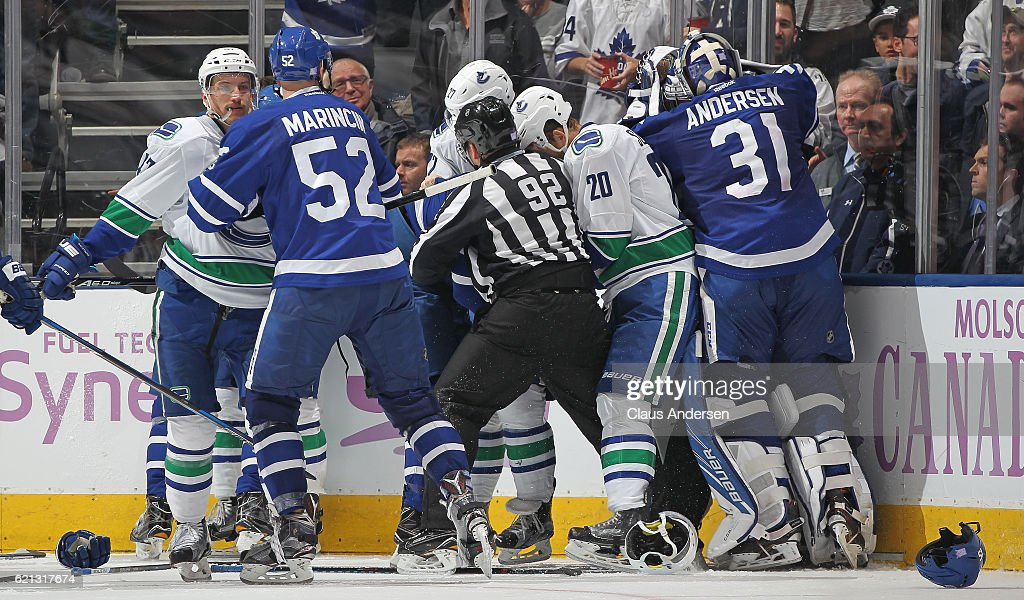 Frederik Andersen #31 of the Toronto Maple Leafs leaves his crease to join in a fight against Ryan Miller #30 of the Vancouver Canucks during an NHL game at the Air Canada Centre on November 5, 2016 in Toronto, Ontario, Canada. The Leafs defeated the Canucks 6-3.