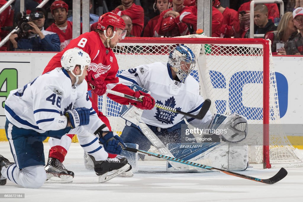 Frederik Andersen #31 of the Toronto Maple Leafs makes a glove save as Justin Abdelkader #8 of the Detroit Red Wings looks for the rebound in front of Roman Polak #46 of the Leafs during an NHL game at Joe Louis Arena on April 1, 2017 in Detroit, Michigan. The Leafs defeated the Wings 5-4.
