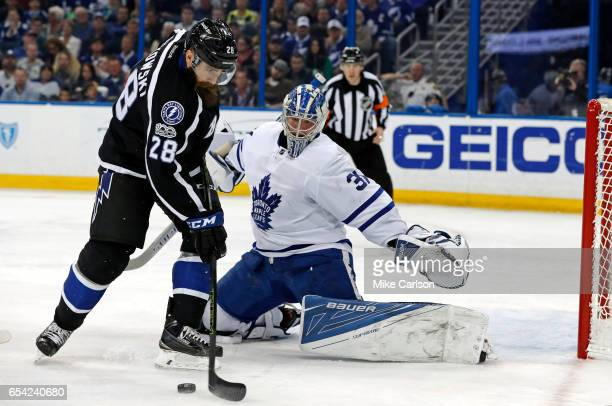 Frederik Andersen of the Toronto Maple Leafs makes a save against Luke Witkowski of the Tampa Bay Lightning during the second period at the Amalie...