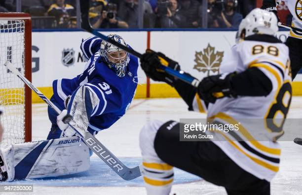 Frederik Andersen of the Toronto Maple Leafs makes a save on David Pastrnak of the Boston Bruins in Game Three of the Eastern Conference First Round...