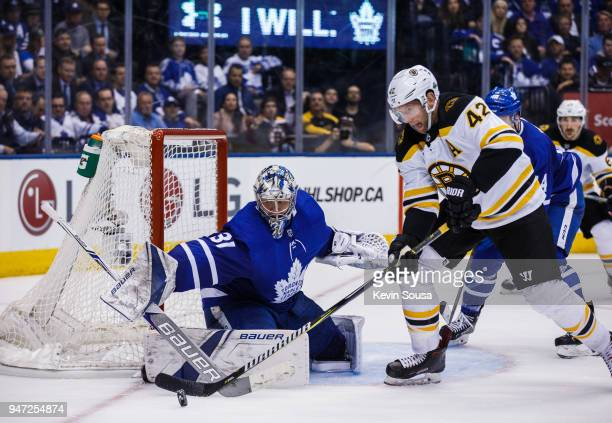 Frederik Andersen of the Toronto Maple Leafs makes a save on David Backes of the Boston Bruins in Game Three of the Eastern Conference First Round...