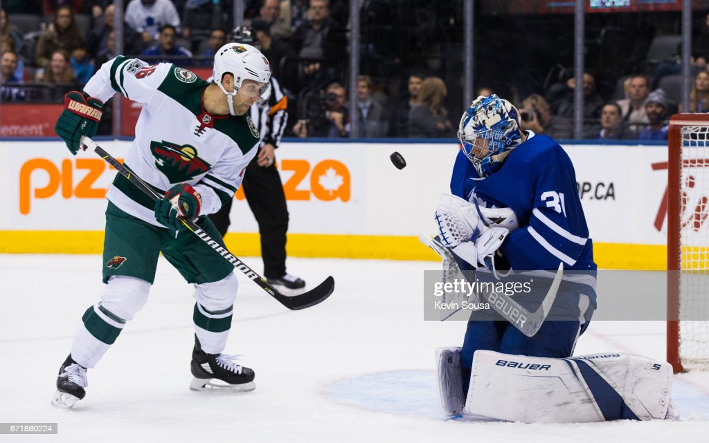Frederik Andersen #31 of the Toronto Maple Leafs makes a save on Jason Zucker #16 of the Minnesota Wild during the third period at the Air Canada Centre on November 8, 2017 in Toronto, Ontario, Canada.
