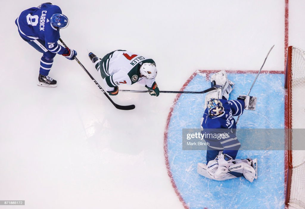 Frederik Andersen #31 of the Toronto Maple Leafs makes a save on Matt Cullen #7 of the Minnesota Wild as Connor Carrick #8 of the Toronto Maple Leafs defends during the third period at the Air Canada Centre on November 8, 2017 in Toronto, Ontario, Canada.