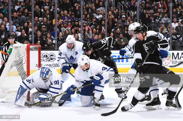 Frederik Andersen of the Toronto Maple Leafs makes a save with help from Alexey Marchenko and Morgan Rielly as they battle against Tyler Toffoli and...