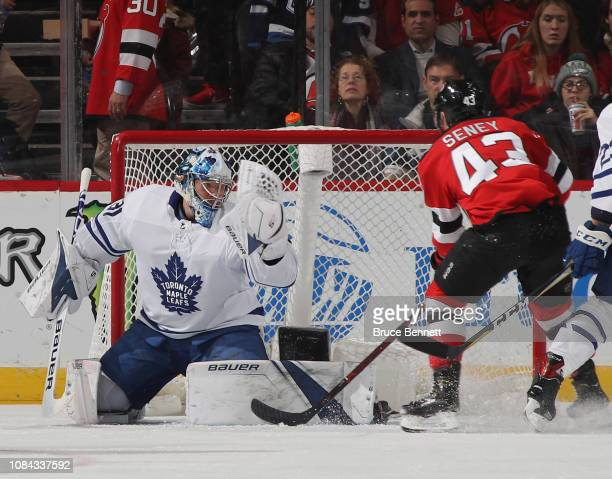 Frederik Andersen of the Toronto Maple Leafs makes the first period save on Brett Seney of the New Jersey Devils at the Prudential Center on December...