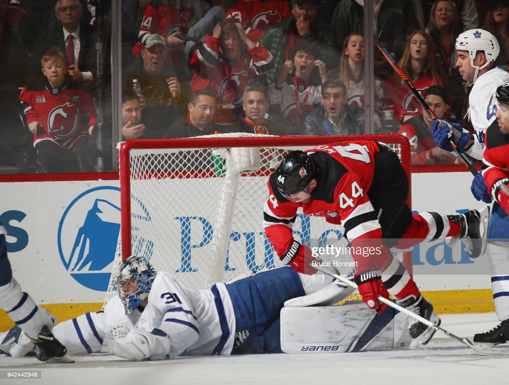 Frederik Andersen #31 of the Toronto Maple Leafs makes the first period save as Miles Wood #44 of the New Jersey Devils looks for the rebound at the Prudential Center on April 5, 2018 in Newark, New Jersey.