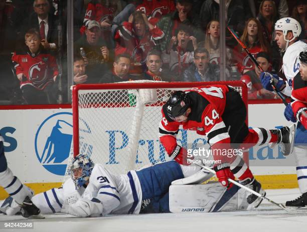 Frederik Andersen of the Toronto Maple Leafs makes the first period save as Miles Wood of the New Jersey Devils looks for the rebound at the...