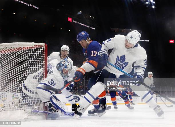 Frederik Andersen of the Toronto Maple Leafs makes the third period save on Matt Martin of the New York Islanders at NYCB Live's Nassau Coliseum on...