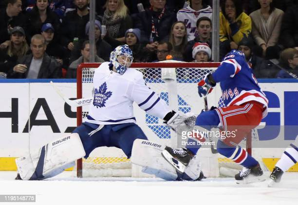 Frederik Andersen of the Toronto Maple Leafs moves across to stop Artemi Panarin of the New York Rangers during the third period at Madison Square...