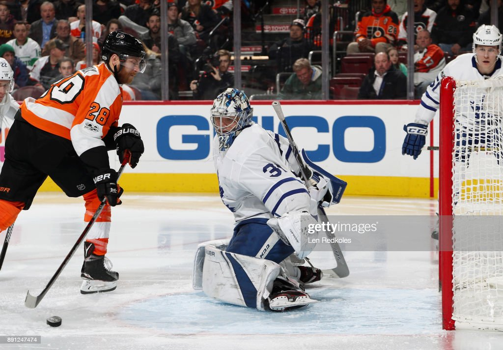 Frederik Andersen #31 of the Toronto Maple Leafs slides across his crease to defend against a scoring chance by Claude Giroux #28 of the Philadelphia Flyers on December 12, 2017 at the Wells Fargo Center in Philadelphia, Pennsylvania.