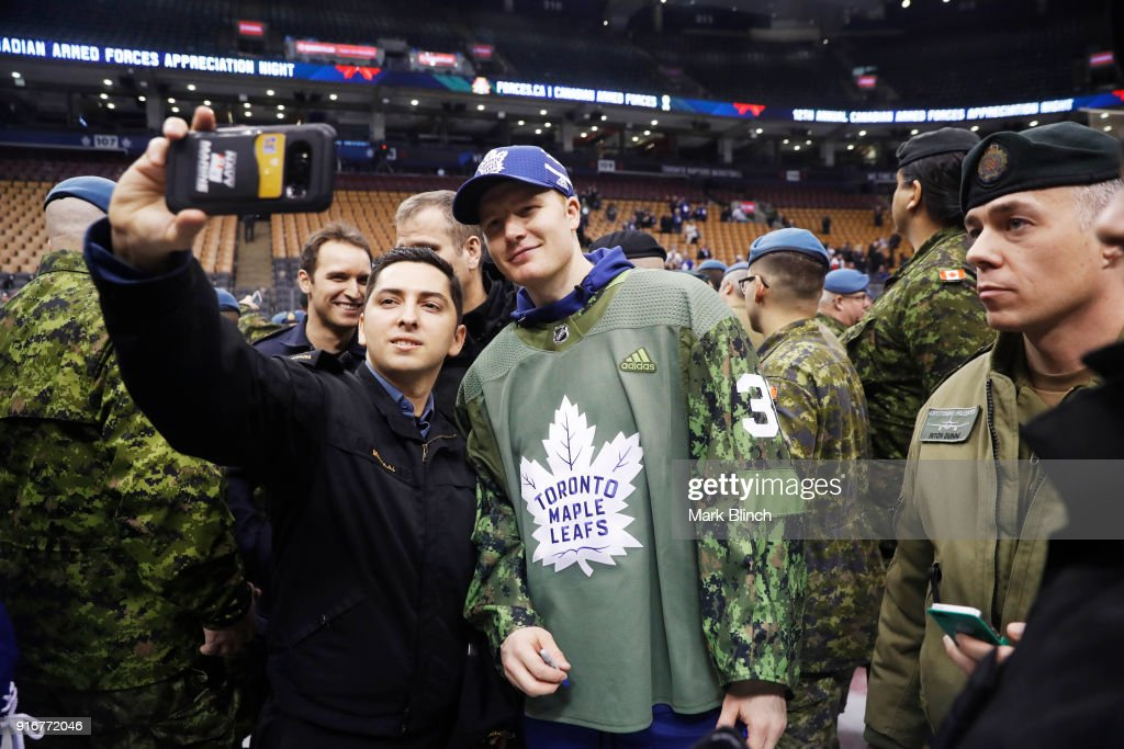 Frederik Andersen #31 of the Toronto Maple Leafs stands with members of the Canadian Armed Forces during Military Night at the Air Canada Centre on February 10, 2018 in Toronto, Ontario, Canada.