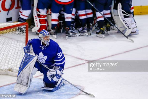 Frederik Andersen of the Toronto Maple Leafs watches the replay after the Washington Capitals defeated the Leafs in Game Six of the Eastern...