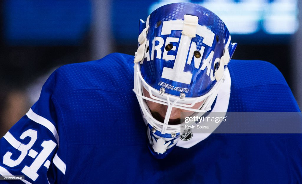 Frederik Andersen #31 of the Toronto Maple Leafs wears an alternate helmet during the third period against the Carolina Hurricanes at the Air Canada Centre on December 19, 2017 in Toronto, Ontario, Canada.