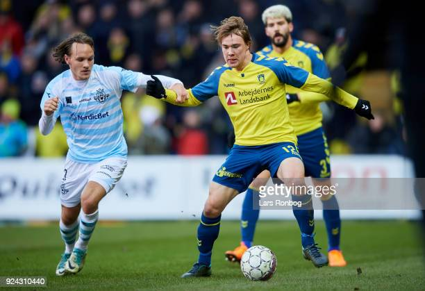 Frederik Bay of FC Helsingor and Simon Tibbling of Brondby IF compete for the ball during the Danish Alka Superliga match between Brondby IF and FC...