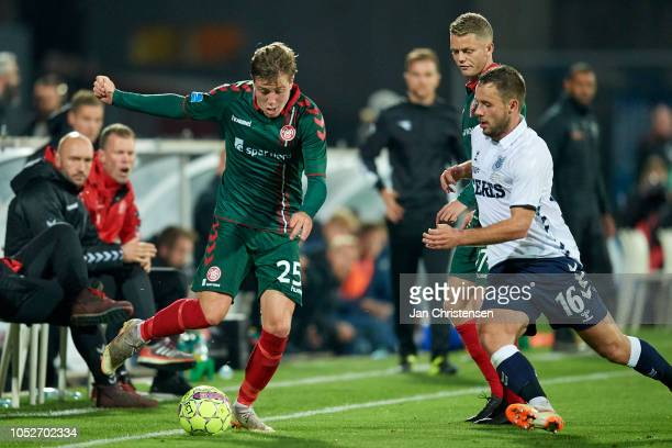 Frederik Borsting of AaB Aalborg and Casper Hojer Nielsen of AGF Arhus compete for the ball during the Danish Superliga match between AGF Arhus and...