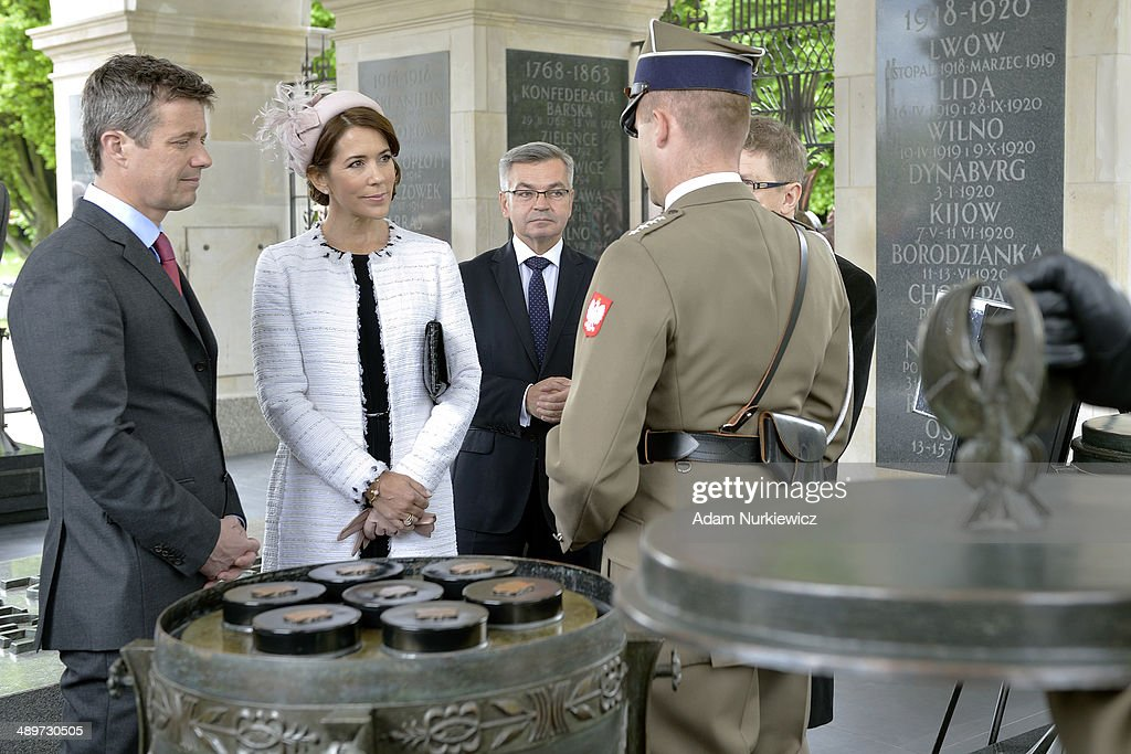 Frederik Crown Prince of Denmark (L) and his wife Crown Princess Mary (R) visit the Tomb of the Unknown Soldier as part of their Poland visit on May 12, 2014 in Warsaw, Poland.
