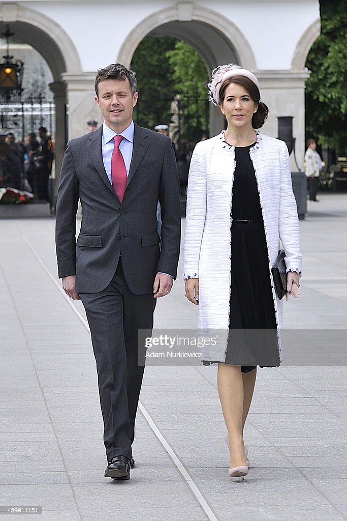 Frederik Crown Prince of Denmark and his wife Crown Princess Mary speak during their visit to the Tomb of the Unknown Soldier as part of their trip to Poland on May 12, 2014 in Warsaw, Poland.