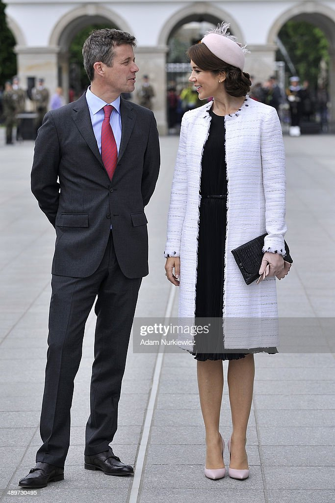 Frederik Crown Prince of Denmark (L) and his wife Crown Princess Mary (R) talk to each other during the Tomb of the Unknown Soldier visit as part of his Poland visit on May 12, 2014 in Warsaw, Poland.