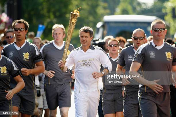 Frederik Crown Prince of Denmark carrries the Olympic Torch through Central London on July 26 2012 in London EnglandThe Olympic flame is making its...