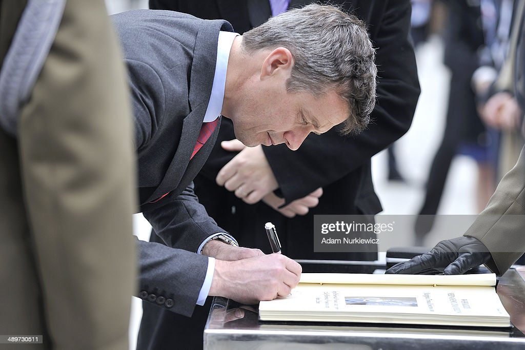 Frederik Crown Prince of Denmark signs book of memory while visit the Tomb of the Unknown Soldier as part of his Poland visit on May 12, 2014 in Warsaw, Poland.