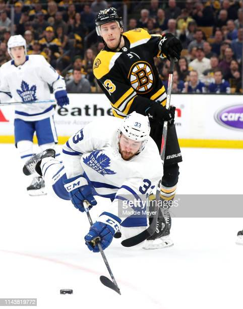 Frederik Gauthier of the Toronto Maple Leafs dives in front of Charlie Coyle of the Boston Bruins for the puck during the first period of Game Five...