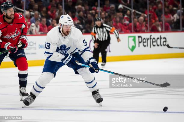 Frederik Gauthier of the Toronto Maple Leafs handles the puck against the Washington Capitals during the third period at Capital One Arena on October...