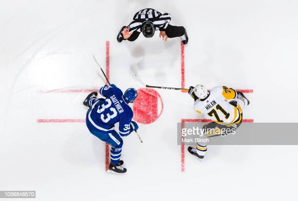 Frederik Gauthier of the Toronto Maple Leafs takes a face off against the Evgeni Malkin of the Pittsburgh Penguins during the first period at the...