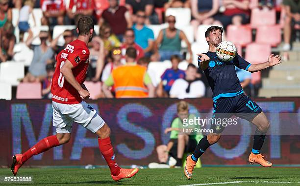 Frederik Holst of Brondby IF and Jens Martin Gammelby of Silkeborg IF compete for the ball during the Danish Alka Superliga match between Silkeborg...