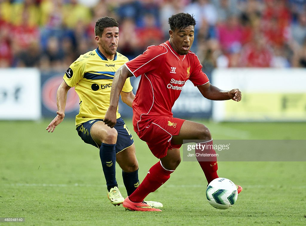 Frederik Holst of Brondby IF and Jordon Ibe of Liverpool FC compete for the ball during the Pre-Season Friendly match between Brondby IF and Liverpool FC at Brondby stadium on July 16, 2014 in Brondby, Denmark.