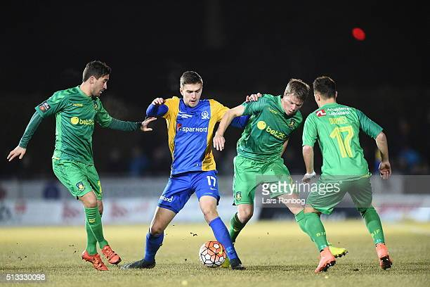 Frederik Holst of Brondby IF Mikael Uhre of Skive IK Jesper Juelsgard of Brondby IF compete for the ball during the Danish Cup DBU Pokalen...