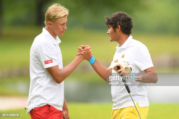 Frederik Korsgaard Sejr of Denmark and Eugenio LopezChacarra Coto of Spain shake hands during the third round of the Toyota Junior Golf World Cup at...