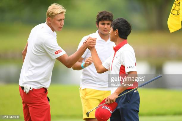 Frederik Korsgaard Sejr of Denmark and Kosuke Suzuki of Japan shake hands during the third round of the Toyota Junior Golf World Cup at Chukyo Golf...