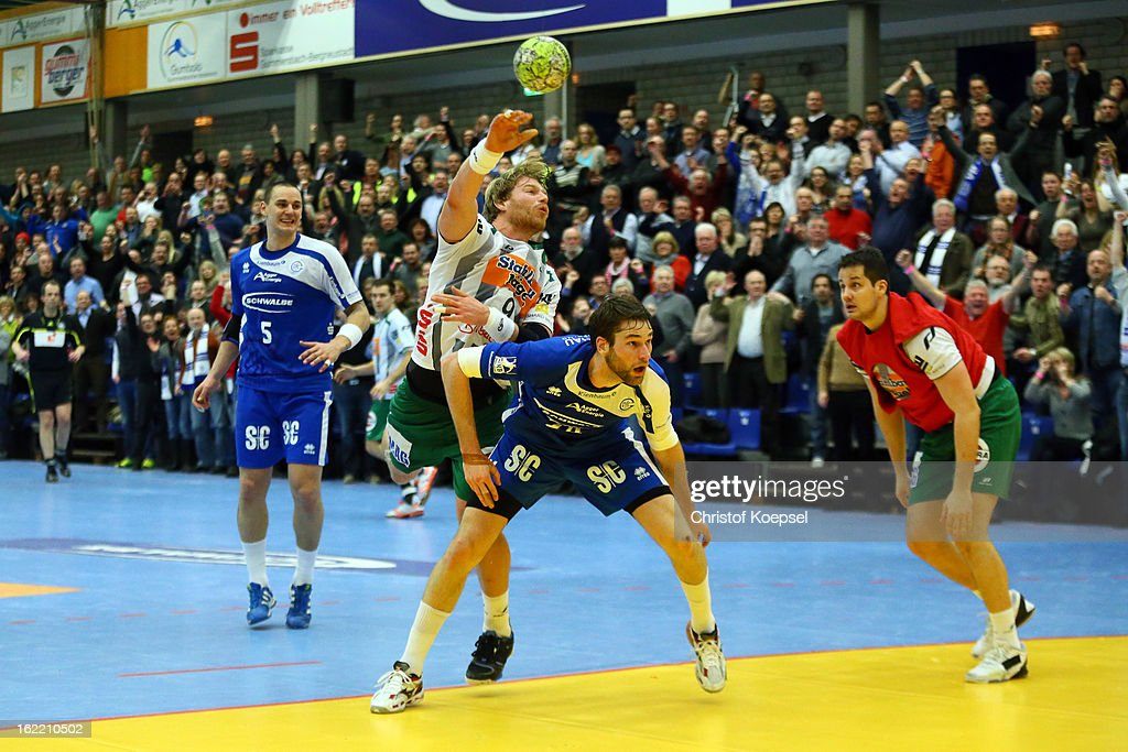 Frederik Larsson of Gummersbach (R) defends against Manuel Spaeth of Goeppingen (L) during the DKB Handball Bundesliga match between VfL Gummersbach and FrischAuf Goeppingen at Eugen-Haas-Sporthalle on February 20, 2013 in Gummersbach, Germany.