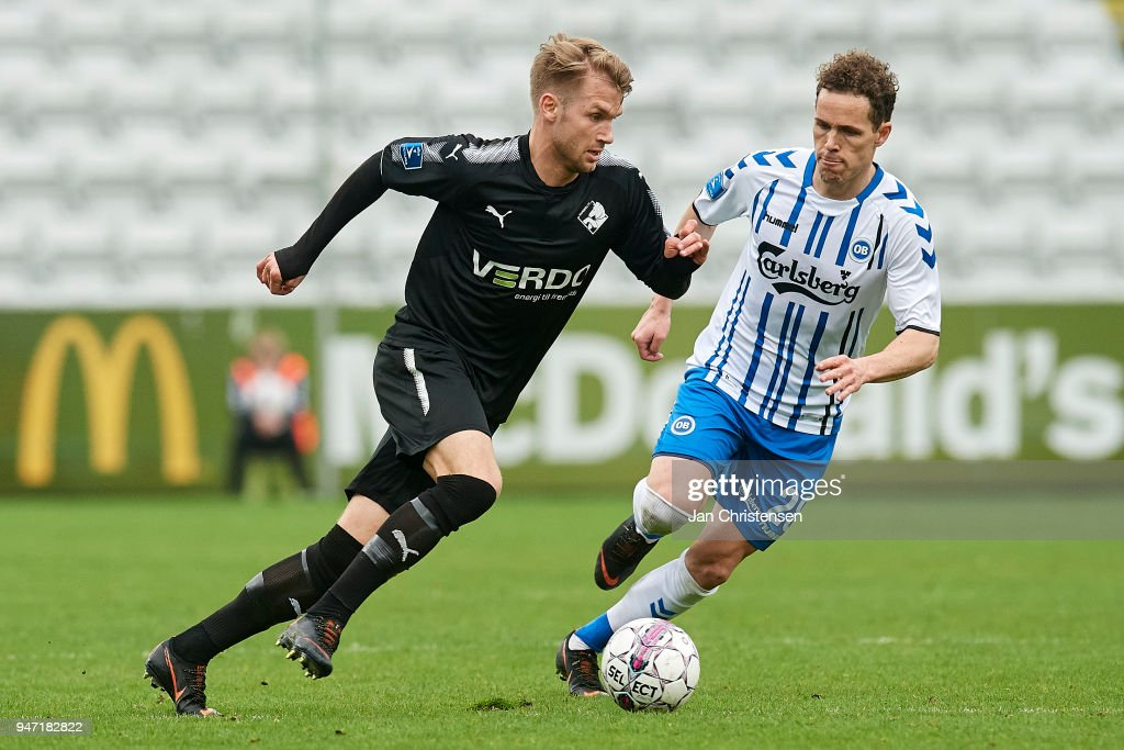 Frederik Lauenborg of Randers FC and Anders K. Jacobsen of OB Odense in action during the Danish Alka Superliga match between OB Odense and Randers FC at EWII Park on April 15, 2018 in Odense, Denmark.