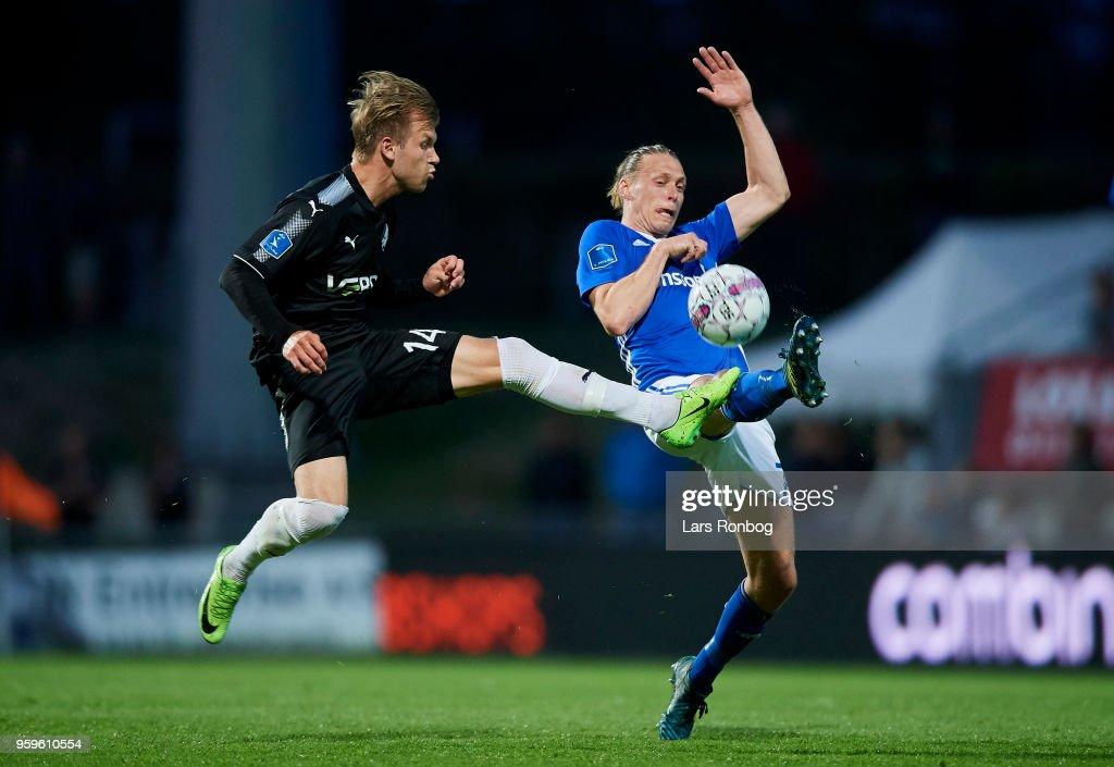 Frederik Lauenborg of Randers FC and Jesper Christjansen of Lyngby BK compete for the ball during the Danish Alka Superliga match between Lyngby BK and Randers FC at Lyngby Stadion on May 17, 2018 in Lyngby, Denmark.