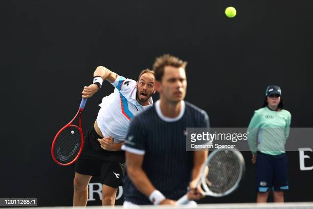Frederik Nielsen of Denmark and Tim Puetz of Germany play in their Men's Doubles first round match against John Peers of Australia and Michael Venus...