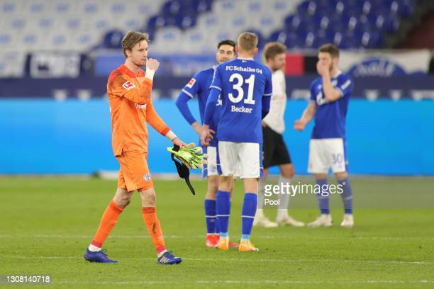 Frederik Roennow of FC Schalke 04 looks dejected after the Bundesliga match between FC Schalke 04 and Borussia Moenchengladbach at Veltins-Arena on...