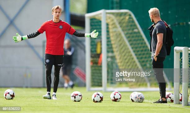 Frederik Ronnow and Kasper Schmeichel watching the Denmark training session at Brondby Stadion on June 2 2017 in Brondby Denmark