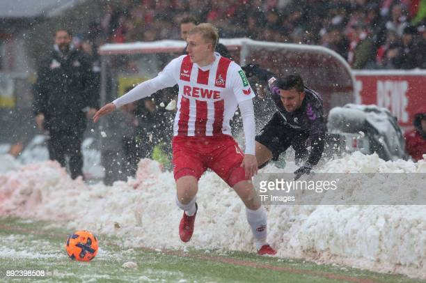 Frederik Soerensen of Koeln and Marco Terrazzino of Freiburg battle for the ball during the Bundesliga match between 1 FC Koeln and SportClub...